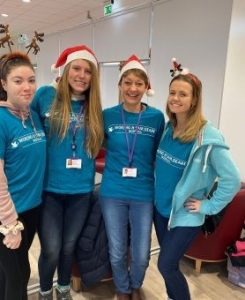 Staff in festive mood at the Woking & Sam Beare Hospice.
